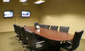 A video conference center pictured on a Louisville court reporter's site.
